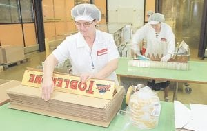 Employees package large Toblerone chocolate bars at the Kraft Jacobs Suchard AG factory in Bern, Switzerland. A study published in the New England Journal of Medicine suggests chocolate can boost brain power. (AP Photo)