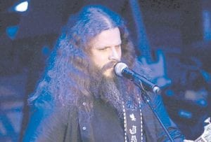 """Jamey Johnson, performing here during the Academy of Country Music Honors show in Nashville, Tenn., pays tribute to Hank Cochran with the release this week of """"Living for a Song: A Tribute to Hank Cochran."""" (AP)"""