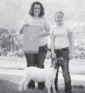 2012 Mountain Heritage Livestock Reserve Champion— Katelyn Back is pictured with her goat 'Sarge'. She is a student at Letcher County Central School. The goat was sold to Dry Fork Auto Sales, Isom Community Pharmacy and Drill Still in the sale of champions.