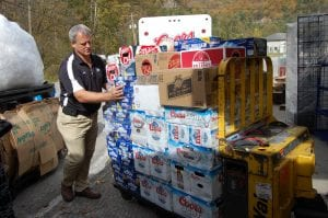 Frank Bentley, branch manager of Clark Distributing of Betsy Layne, helped move the first load of beer into Food City early Friday afternoon.