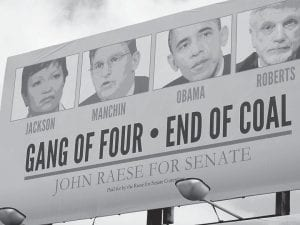 """Republican candidates are using the idea of a """"war on coal"""" in their campaigns this year, as in this sign that targets incumbent Democratic U.S. Sen. Joe Manchin, who is generally considered to be friendly to legislation important to the coal industry, in Morgantown, W.Va. (AP Photo)"""
