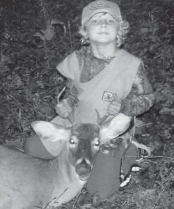 YOUNG HUNTER — At the age of six years old, Carter Lee Dollarhyde, son of Brandon and Vanessa Dollarhyde of Colson, killed his first buck on Oct. 13 during the Youth Hunt. He killed this four-point buck around the Colson area while hunting with his mother and his papaw, Jeffery Hammonds. Carter is a first grade student at West Whitesburg Elementary School.