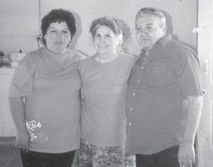 REUNION — Brenda and Dexton Howard posed for a picture with Oma Hatton at the Howard family reunion in Garrett, Ind., a few years ago. Both of the Howards are very sick now.