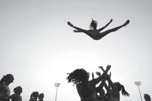 A cheerleader from Nampa High School was thrown into the air as the cheer squad practiced their stunts before a game in Nampa, Idaho. In a new policy statement released this week in the journal Pediatrics, the American Academy of Pediatrics says school sports associations should designate cheerleading as a sport, and make it subject to safety rules and better supervision. (AP Photo/The Idaho Press-Tribune)
