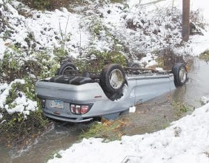 — A Ford Mustang automobile lay partially submerged in Thornton Creek on Tuesday, several hours after the car's driver lost control during a heavy snowstorm that hit Letcher County and left more than 3,000 homes without power. Kentucky Power Company said some homes could be without electricity until Friday.