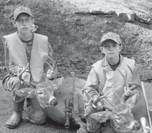 — Owen and Kane Gibson killed these deer during the recent Youth Hunt. They are the sons of Owen and Nikki Gibson of Cowan, and grandsons of Leonard Boggs of Cowan and the late Kay Boggs, Codell and Debbie Gibson of Craft's Colly, and Carlene and Kenneth Oliver of Columbia.