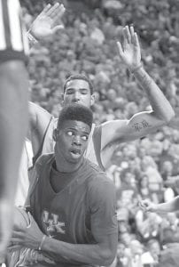 Nerlens Noel, bottom, was pressured by Willie Cauley-Stein during Kentucky's NCAA college basketball Blue-White scrimmage at Rupp Arena in Lexington last week. (AP Photo/James Crisp)