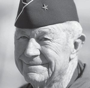 """Retired Air Force Brig. Gen. Charles """"Chuck"""" Yeager talked with reporters after a re-enactment flight commemorating his breaking of the sound barrier 65 years ago on Oct. 14 at Nellis Air Force Base, Nev. (AP Photo)"""