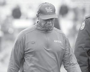 Kentucky head coach Joker Phillips walked off the field after his team's 40-0 loss to Vanderbilt. He was fired a day later. (AP Photo/James Crisp)