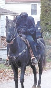Josh Howard of Chopping Branch in McRoberts, was the Headless Horseman on Nov. 2 while children were out trickor treating after waiting two days because of the snowstorm caused by Hurricane Sandy. Howard's neighbors said they hope he continues to dress up for years to come.
