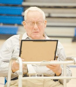 """Luther Meade, 87, of Kingscreek, shed tears of joy as he looked at the high school diploma he was presented Monday during a Veterans Day event at Letcher County Central High School. Meade, a World War II veteran, was surprised with the diploma from the old Kingdom Come High School. """"It tickled me to death,"""" said Meade. """"It means a whole lot."""" Meade founded Meade & Shepherd Coal Company along with his brother Talmage Meade and Lawrence Shepherd. (Photo by Sally Barto)"""