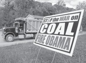 Signs like this one dotted the landscape in the coalfields of Central Appalachia leading up to last week's Election Day standoff between Republican Mitt Romney and President Obama. (AP photo)