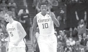 Kentucky's highly-touted freshman Archie Goodwin (10) reacted with sophomore Jarrod Polson (5) after scoring against Maryland during the first half of Kentucky's narrow win. (AP Photo)