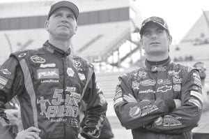 WHEN TIME WERE HAPPIER (SOMEWHAT) — Clint Bowyer, left, and Jeff Gordon, right, were photographed together while looking on during qualifying for the October 28 Sprint Cup Series auto race in Martinsville, Va. (AP Photo/Autostock, Nigel Kinrade)