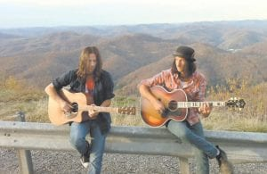 — Los Angeles musicians Mark Tremalgia (left) and Mark Knight took advantage of the past weekend's beautiful weather to visit Pine Mountain near Whitesburg. Former members of the Eighties rock band Bang Tango, the two are on a mini-tour through the southeastern United States and will appear at Summit City in Whitesburg on Saturday night.