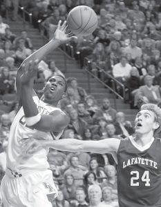 The play of Kentucky's Alex Poythress (left) is one reason to be thankful at this time of year if you're a Wildcat fan. Poythress is shown here being fouled by Lafayette's Levi Giese at Rupp Arena November 16. Poythress, the SEC's freshman of the week, followed up a 20-point effort in his team's 75-68 loss to Duke by hitting nine of 10 shots for a career-high 22 points to go with five rebounds against Lafayette. (AP Photo/James Crisp)