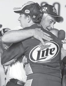 Brad Keselowski hugged owner Roger Penske after winning the NASCAR Sprint Cup Series title. (AP Photo)
