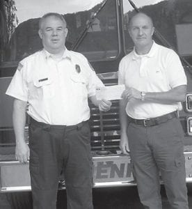 — Sam Carter, director of Business Development for TECO Coal Corporation, presented a $1,600 check to Rick Caudill, chief of the Jenkins Volunteer Fire Department, to purchase a pump for one of the department's fire trucks. TECO Coal also recently donated $150 for the 2013 Jenkins Fire and Rescue calendar, $500 to the Jenkins Homecoming Days Festival Committee and $500 to the Jenkins Education Foundation.