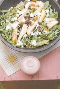 An arugula pear salad with pomegranate vinaigrette and goat cheese served in a bowl. (AP)