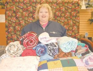 Doris Banks is collecting lap throws for nursing home residents and veterans. So far she has collected 240 throws.