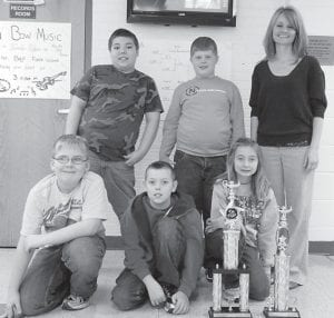 FIRST PLACE — The Martha Jane Potter Elementary School academic team finished in first place in the elementary division of the Letcher County Academic League tournament. Pictured are (top row, left to right) Nick Vance, Seth McCray, coach Jamie Burgett, (bottom row) Austin Triplett, Luke Goins and Sarah McAuley. Not pictured are Luke Holcomb and Gracie Gibson.