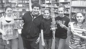 The Whitesburg Middle School academic team placed first overall at the Letcher County Academic League Tournament. The WMS quick recall team also placed first. Pictured are Machayla Ashby, John Ison, Samantha Crawford, Sadie Bates and Abby Enfusse. Machayla placed fifth in English Composition. John placed second in Arts and Humanities. Sadie placed first in Language Arts and first in Math. Abby placed third in English Composition. Not pictured is Dalton McCown, who placed first in English Composition and first in Science.