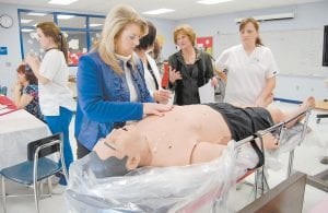 IT'S ALIVE (SORT OF) — Letcher Schools Assistant Superintendent Twyla Messer looked at a new $46,000 life-sized interactive human simulator designed to help students in the nurse aide and medical assistant programs learn how to diagnose illnesses. Also pictured are Sybil Shell of Mountain Comprehensive Health Corporation, Vivian Back, instructor at the Letcher County Area Technology Center, and Dana Sexton of Letcher Manor Nursing Home.