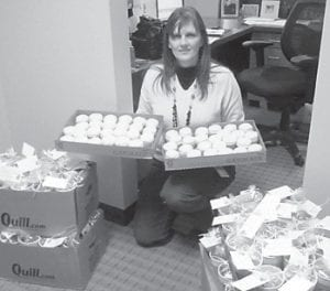 The staff of Hospice of the Bluegrass recently received thanks from Letcher Manor Nursing & Rehabilitation for its hard work and ongoing care of the region's patients. November is National Hospice Awareness Month. Pictured is a staff member of Hospice of the Bluegrass receiving treats from Letcher Manor.