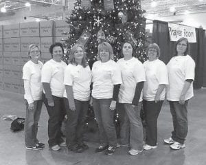 A team of women from Whitesburg First Baptist Church served in the Samaritan's Purse, Operation Christmas Child Shoebox Processing Center in Charlotte, N.C., Nov. 26 through Nov. 30. The group worked alongside more than a thousand other volunteers to inspect and prepare gift-filled shoeboxes for shipment to needy children. The Southeast Kentucky Collection Site in Whitesburg donated 8,988 giftfi lled shoeboxes to Samaritan's Purse. Pictured (left to right) are Roxie Smith, Beth Little, Jennifer Day, Lee Adams, Elisa Cook, Donna Fleming and Sharon Short.