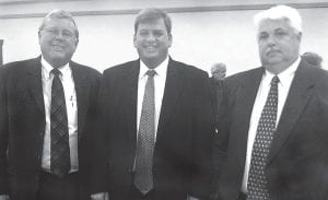 Letcher County Judge/Executive Jim Ward, center, posed for a photo after being elected chairman of the Kentucky Coal County Coalition, an organization of 29 coal producing counties and 35 other counties impacted by the coal industry formed organized to work with state government to promote the coal severance tax and use of the tax for the economic development and improvement in the quality of life in the coalfields. Posing with Ward were (left) Richard Tanner, executive director of the coalition, and Martin County Judge/ Executive Kelly Callaham, the group's immediate past president.