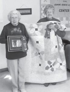 Judith Vermillion (left) won second place in Digital Photo in the Golden Arts competition in Hazard, and Coleene Hart took second place with her Rosie Posie hand-quilted quilt.