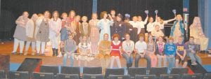 "— The Fleming-Neon Middle School drama team will perform ""Annie Jr."" this week in the Letcher County Central High School Auditorium. The cast and crew is made up of sixth-, seventh- and eighth-grade students. Students have taken acting classes and vocal training, all offered through FNMS. Funding is provided by 21st Century Community Learning Centers. B. Keith Adams is the director of the musical production. Gracie Maggard is the FNMS principal. Public performances will be held in the LCCHS auditorium on at 7 p.m. on Saturday, December 15 and 2 p.m. on Sunday, December 16. Admission is $5. This is the first Fleming-Neon production. Cast members shown in photo above are (front row, from left) Kirsten Gibson, Amber Bolling, Emma Maggard, Taylor Herrell, Ally Caudill, Quade Adams, Lindsay Bentley, Autumn Wright, Gage Isaac, Avery Stamper, Noah Brock, (back row) Hannah Adams, Haley Fields, Iris Wynn, Shania Combs, Emily Craft, Cameron Kincer, Lindsey Yonts, Deidra Banks, Selena Rowlett, Autumn Stamper, Kiley Short, Skyler Yonts, Harleigh Fleming, Kori Cornett, Abbi McKinney, Skylar Griffith, Amber Rowlett, Graham McKinney, Sara King and Belle Wright. (Photo by Sally Barto)"