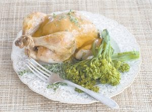 A herb roasted Cornish game hen with creamy mustard sauce makes a grand Christmas roast on a small scale. (AP Photo/Matthew Mead)