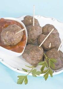 Cocktail meatballs with cranberry marinara. (AP)