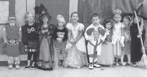 HALLOWEEN FUN was had by these children at story hour at the Harry M. Caudill Memorial Library in Whitesburg. Pictured (left to right) are Mason Boggs, Raegan Turner, Macey Warf, Evany Pack, Presley Sloan, Jace Bates, Maggie Little, Matty Frohnapfel, Hannah Burns and Anna Little.