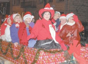 Members of Letcher County Mountain Mamas chapter of the Red Hat Society greeted parade-goers with smiles and waves as they made their way through the City of Whitesburg's annual Christmas parade. Originally formed in 1988 for women aged 50 and over, the Red Hat social organization, one of the world's largest, is now open to women of all ages.