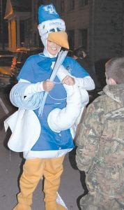 Tricia Baker was dressed in a stork's costume while she handed out glow-sticks for the Whitesburg Women's Center.