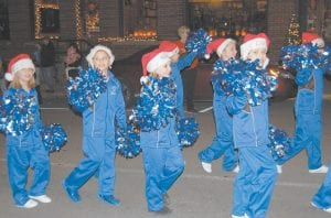 Members of the Cowan Elementary School cheerleading team were full of holiday spirit as they marched up West Main Street in Whitesburg during the annual Christmas parade.