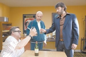 "John Goodman, left, Alan Arkin, center, and actor-director Ben Affleck in a scene from ""Argo,"" AP critic Christy Lemire's choice for best film of 2012. (AP Photo/Warner Bros.)"