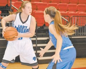 Letcher County Central Lady Cougar Cheyanne Stidham (left) was focused on the task at hand in the VA/KY Border War tournament at UVA-Wise last week. (Photo by Brandon Meyer/B. Meyer Images)