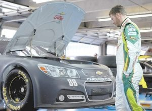 NASCAR driver Dale Earnhardt Jr. looked on in the garage area during testing of the new Sprint Cup car at Charlotte Motor Speedway earlier this month. (Getty Images for NASCAR photo)