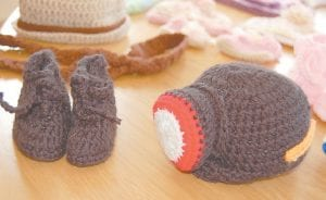 This version of a coal miner's safety cap and lamp and miner's boots are among the most popular items being crocheted by Alice Craft of Little Cowan.
