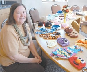Alice Craft, of Little Cowan, is seen with some of the original items she has crocheted. The photograph was taken last week at the Letcher County Cooperative Extension Office in Whitesburg, where Mrs. Craft works.