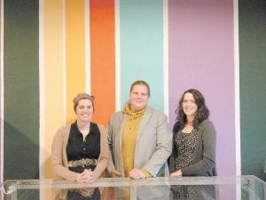 Owners/operators of Here Comes the Bun are, from left, Becca Peterson, Kyle Kadel and Carrie Wells. The bakery is located in the old Hoover's clothing building.