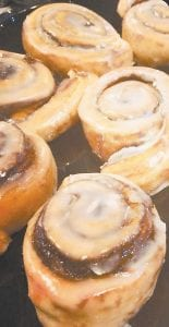 The owners of Here Comes the Bun on Main Street have been practicing making cinnamon buns before the bakery opens later this week.