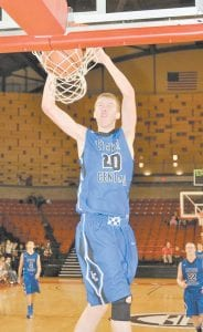 Letcher County Central junior forward Josh Owens dunked the ball for two points during the Cougars' loss to Daniel Boone High School of Gray, Tenn. (Photo by Brandon Meyer/B. Meyer Images)