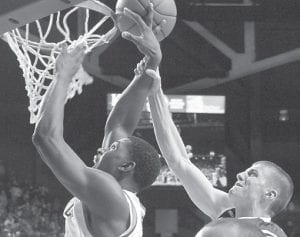 Kentucky's Alex Poythress, left, was fouled by Portland's David Carr during action earlier this season. (AP Photo)