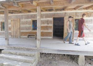 Jordan Stamper, right, and James Ball looked over a cabin that marks the site of key events in the Hatfield- McCoy feud. Artifacts unearthed last year appear to pinpoint the location of an 1888 ambush on Randolph McCoy's cabin by the Hatfield clan in the woods of eastern Kentucky. Excavators found bullets believed to have been fired by the McCoys in self-defense. The finding wasn't announced until this week. (AP Photo)