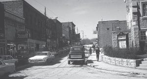 Whitesburg's Main Street was abuzz when former Whitesburg Appalachian Regional Hospital physician John Engle took this photograph on a winter's day 49 years ago, in January 1964. Much has changed since. Or has it?