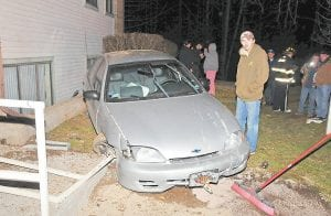 — No one was injured Sunday when a mechanical failure caused the driver of this Chevrolet Cavalier to lose control of the automobile as he drove near the Mountain Breeze Apartments at Burdine. Jenkins Police Chief Jim Stephens said driver Jack Sturgill, shown standing beside the vehicle, had been working on the car for its owner, Sherry Hale. A steering failure caused Sturgill to lose control, said Stephens, adding that neither drugs, nor alcohol or speed factored into the accident. (Photo by Chris Anderson)